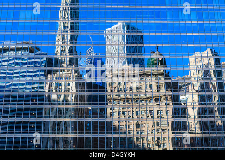 Buildings on West Wacker Drive reflected in the Trump Tower, Chicago, Illinois, USA - Stock Photo
