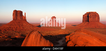 Panoramic photo of the Mittens at dusk, Monument Valley Navajo Tribal Park, Utah, USA - Stock Photo