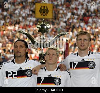 Players of Germany's national soccer squad (L-R) Kevin Kuranyi, Bastian Schweinsteiger und Per Mertesacker listen - Stock Photo