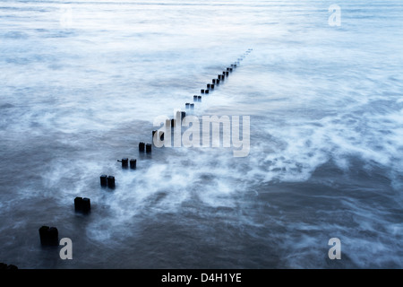Groynes and incoming tide at Bridlington, East Riding of Yorkshire, England, UK - Stock Photo