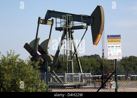 A 'Winterhall' sign post seen in front of a pumpjack-type oil pump near Emlichheim, County Bentheim, Germany, 28 - Stock Photo