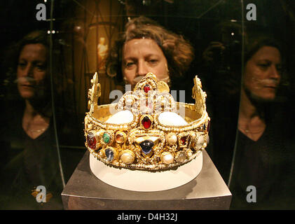 A visitor takes a look at the 'Essen Crown' from the 11th century in an exhibition of the Essen cathedral treasure - Stock Photo
