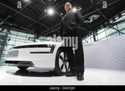 Volkswagen chairman of the managing board Martin Winterkorn stands next to a Volkswagen 1-litre car XL1 during the - Stock Photo