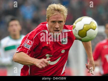 Hanover's Mike Hanke seen in action during the Bundesliga soccer match Hanover 96 vs Werder Bremen at 'AWD-Arena' - Stock Photo