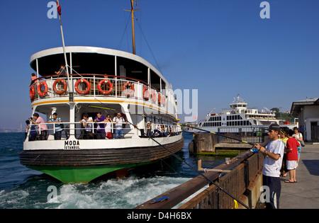 Ferry and fisherman on the Bosphorus, Istanbul, Turkey, Eurasia - Stock Photo