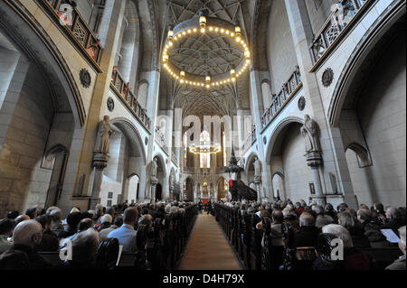 Protestant Christians attend the festival service on the occasion of Reformation Day at the crowded Schlosskirche - Stock Photo