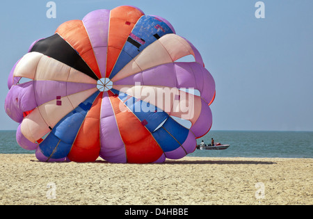 generic tropical shot of paragliders about to take flight over the ocean and beach area of Goa India - Stock Photo
