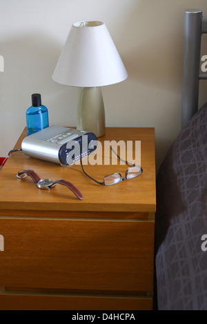 Bedside table with lamp clock radio watch and specs stock photo new bedside table with lamp clock radio watch and specs stock photo mozeypictures Image collections