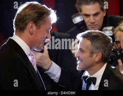 Chairman of the Executive Board of Axel Springer AG Mathias Doepfner (L) talks to US actor George Clooney during - Stock Photo