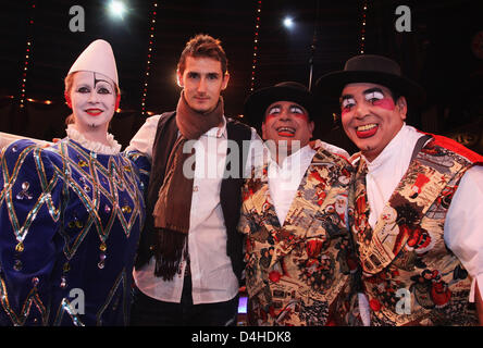 German Bundesliga club FC Bayern Munich?s striker Miroslav Klose (2-L) poses with clowns during the FC Bayern Circus - Stock Photo