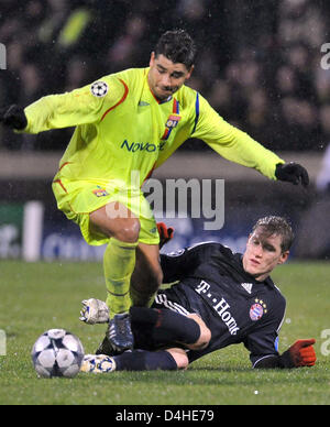Ederson (L) of Olympique Lyon vies for the ball with Bastian Schweinsteiger of FC Bayern Munich during the Champions - Stock Photo