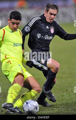 Ederson (L) of Olympique Lyon vies for the ball with Philipp Lahm of FC Bayern Munich during the Champions League - Stock Photo