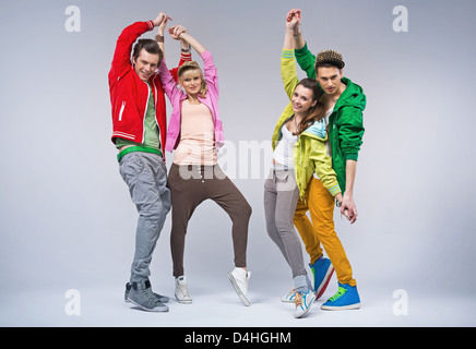 Two hip-hop style couples dancing together and smiling - Stock Photo