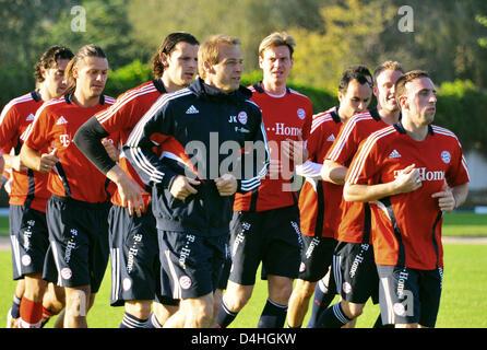 Luca Toni (L-R), Martin Demichelis, Daniel van Buyten, coach Juergen Klinsmann, Tim Borowski, Landon Donovan, Christian - Stock Photo