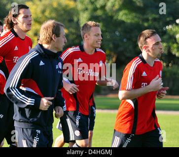 Daniel van Buyten (L-R), coach Juergen Klinsmann, Christian Lell and Franck Ribery of German Bundesliga soccer club - Stock Photo