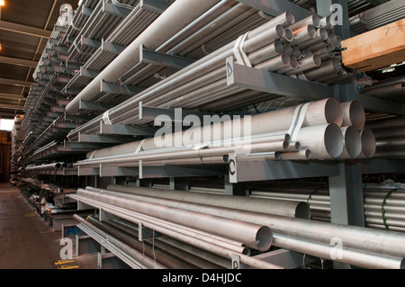 Steel tubes stacked in a warehouse at a steel stock holders in the West Midlands, UK - Stock Photo