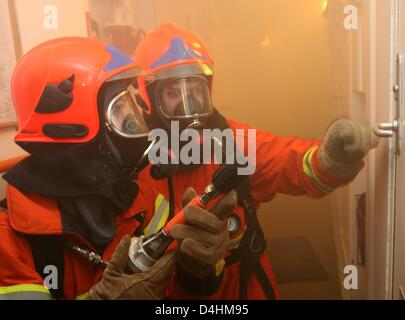 Danish navy soldiers practice fire emergency measures onboard fregate ?Thetis? off the coast of Neustadt, Germany, - Stock Photo