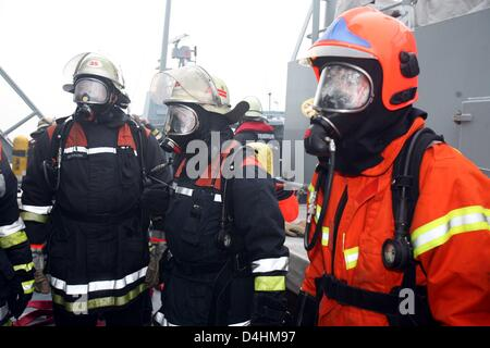 Danish navy soldiers and Hamburg-based firemen practice fire emergency measures onboard fregate ?Thetis? off the - Stock Photo