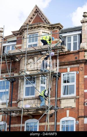 Scaffolders working in London - Stock Photo