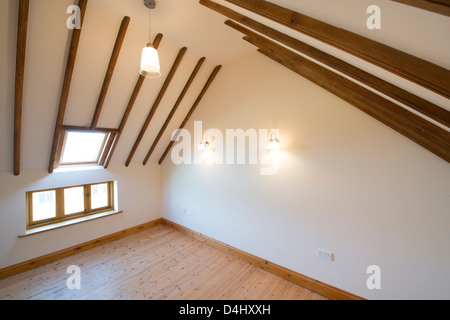 Loft conversion in a newly converted barn in rural England. - Stock Photo