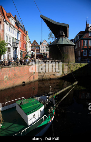 Altes Land, Stade, boat WILLI and the old crane in the old harbor, Lower Saxony, Germany - Stock Photo
