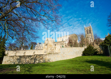 View towards the Cathedral with the Medieval Bishops Palace in the foreground Temple Gardens Lincoln Lincolnshire - Stock Photo