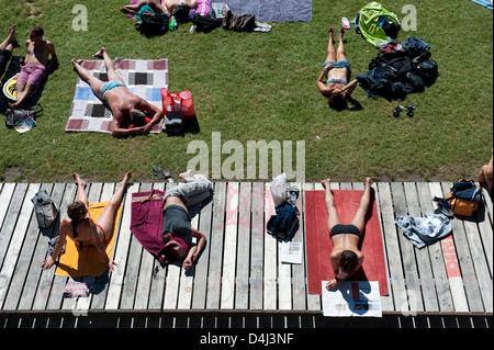 Zurich, Switzerland, tourists Flussbad Unterer Letten on the banks of the Limmat - Stock Photo