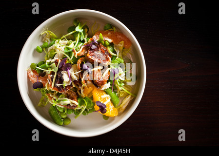 Fresh Peas and Crab Salad with Orange and Grapefruit prepared by Rob Ruban, Executive Chef of Crossbar in New York, - Stock Photo