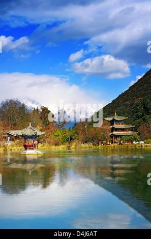 Landscape photo of Beautiful Pavilion In Black Dragon Pool Park, Lijiang Yunnan Province, China - Stock Photo
