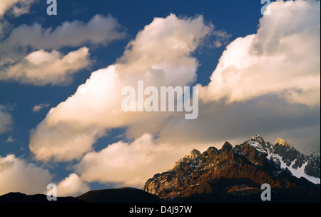 Landscape of the peak of Yulong Snow Mountain in Yunnan China - Stock Photo
