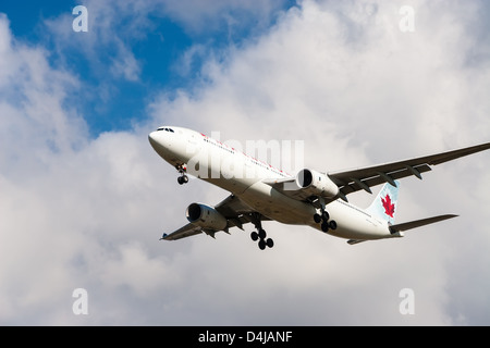 Air Canada aircraft approaching Vancouver International Airport - Stock Photo