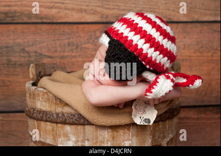 Newborn Baby Boy Wearing a Pirate Hat and Eye Patch - Stock Photo