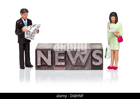 Hand painted business figurines and the word NEWS in old metal letterpress isolated on a white background. - Stock Photo