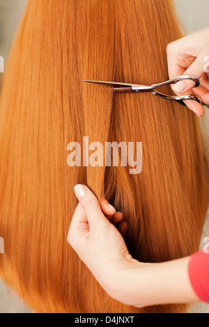 straight healthy woman hair and scissors - Stock Photo