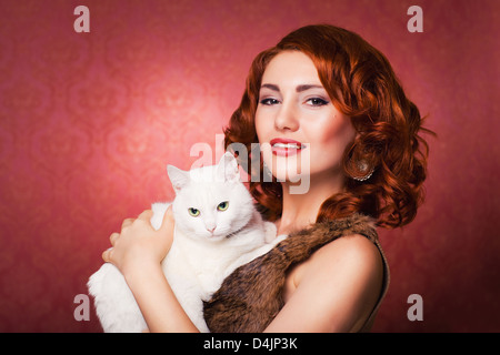 red beautiful fashion girl with white fluffy cat