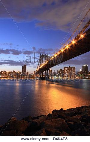 New York City lit up at night - Stock Photo