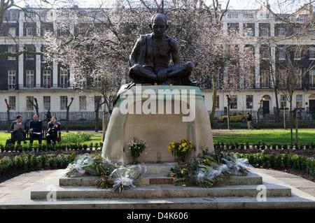 The statue of Mahatma Gandhi in Tavistock Square, Bloomsbury, London. - Stock Photo