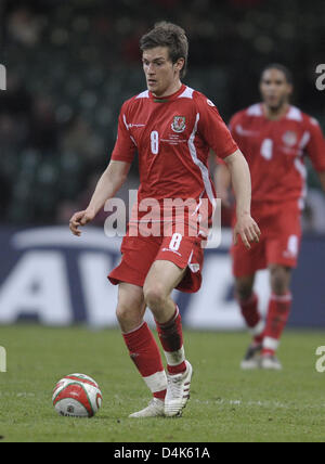 Welsh international Aaron Ramsey seen in action during the FIFA 2010 World Cup qualifier Wales vs Germany in Cardiff, - Stock Photo