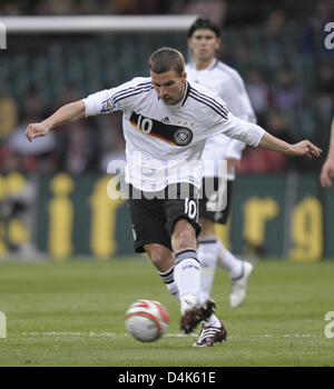 German international Lukas Podolski seen in action during the FIFA 2010 World Cup qualifier Wales vs Germany in - Stock Photo