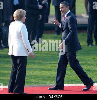 German Chancellor Angela Merkel welcomes U.S. President Barack Obama to the 2009 NATO Summit in Kehl, Germany, 04 - Stock Photo