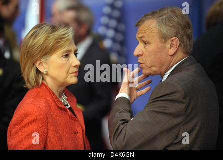 US Secretary of State Hillary Clinton (L) talks with NATO Secretary-General Jaap de Hoop Scheffer (R) during the - Stock Photo