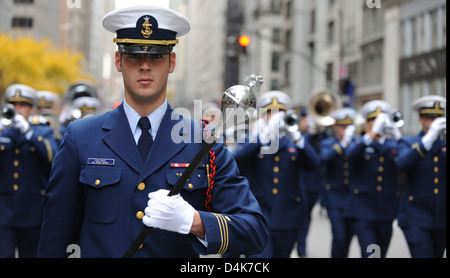 Coast Guard Cadet Christopher Salinas marches down 5th Ave. - Stock Photo