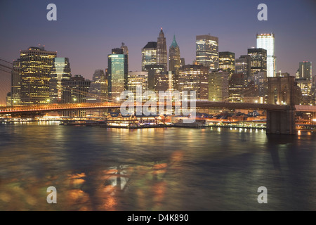 New York City lit up at night - Stock Photo