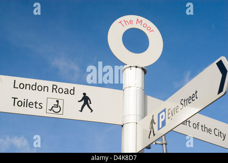 Street signpost on The Moor pointing to London Road and public toilets, Sheffield, UK - Stock Photo
