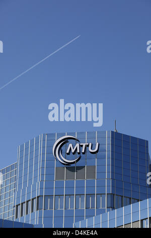 A plane flies above the headquarters of MTU Aero Engines in Munich, Germany, 03 June 2009. Photo: Lukas Barth - Stock Photo
