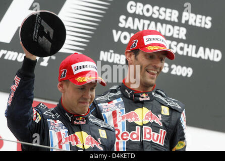 Australian Formula One driver Mark Webber (R) of Red Bull Racing and his German teammate Formula One driver Sebastian - Stock Photo