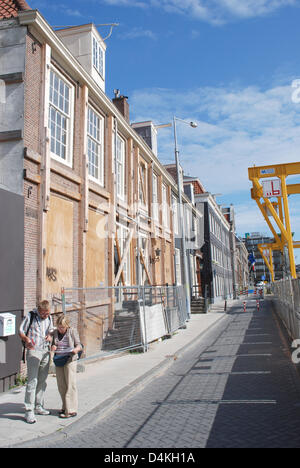 Evacuated and fenced off houses are pictured next to an underground building site in the city centre of Amsterdam, - Stock Photo