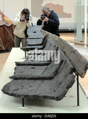Photographers take pictures of the wreck of a Roman cargo ship at the Roman Museum in Haltern, Germany, 29 April - Stock Photo