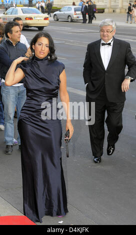 Former German Foreign Minister Joschka Fischer (R) and his wife, producer Minu Barati-Fischer arrive at the German - Stock Photo