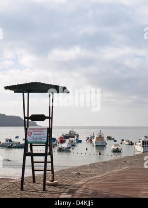 Playa San Juan on the west coast of Tenerife Spain, tourist resort and fishing port, life guard not on duty - Stock Photo